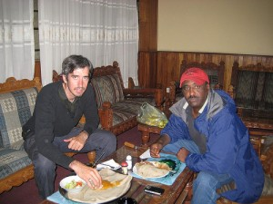 Joel and a new friend in Africa.